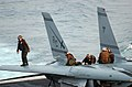 US Navy 041118-N-6125G-025 Line Personnel clean and inspect an F-14B Tomcat after a day of flight operations.jpg