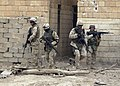 US Navy 041208-N-4614W-001 U.S. Navy Seabees, assigned to Naval Mobile Construction Battalion Two Three (NMCB-23), secure a severely damaged school in Fallujah, Iraq.jpg