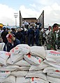US Navy 050104-N-9403F-273 Volunteer Sailors assigned to USS Abraham Lincoln (CVN 72) assist relief efforts at Bande Aceh Airport in Sumatra, Indonesia.jpg