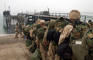 US Navy 050226-N-6932B-106 Marines assigned to the 31st Marine Expeditionary Unit (MEU) file aboard a Landing Craft Utility (LCU) on board Kuwait Naval Base, Kuwait.jpg