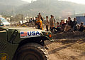 US Navy 051103-N-1261P-017 U.S. Navy Seabees assigned to Naval Mobile Construction Battalion Seven Four (NMCB-74), arrive at the Dewan Tent Village in Muzaffarabad, Pakistan to remove debris.jpg