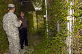 US Navy 060108-N-2568S-047 Led by Joint Task Force Guantanamo Commanding General, Maj. Gen. Jay Hood, Secretary of the Navy (SECNAV), Dr. Donald C. Winter, inspects the heavily overgrown remains of Camp X-ray.jpg