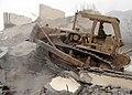 US Navy 060224-N-3579G-003 Equipment Operator Constructionman Nathan Luetjen assigned to Naval Mobile Construction Battalion Four (NMCB-4) Det. Pakistan operates a bulldozer at a Pakistani demolition site.jpg
