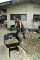 US Navy 060528-N-1577S-054 Constructionman Todd Beeler assigned to Naval Mobile Construction Battalion Four Zero (NMCB-40) shovels dirt into a wheelbarrow in preparation to replace a walkway at Zamboanga Medical Center.jpg