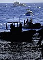 US Navy 060831-N-6616W-089 Landing Craft Utility (LCU) 1658 and several Ridged Hulled Inflatable Boats (RHIB) assigned to Helicopter Mine Countermeasures Squadron One Five wait to enter the well-deck aboard the amphibious assau.jpg