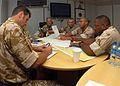 US Navy 070529-N-0448N-023 Combined Task Force (CTF) 158 command and control center afloat forward staging base, known as Ocean 6, and CTF 59 discuss ways to resolve an oil spill.jpg
