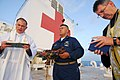 US Navy 070619-N-6081J-014 Lt. Cmdr. Paul Evers, a Navy chaplain aboard the Military Sealift Command hospital ship USNS Comfort (T-AH 20), recites memorial rites for Robert Lee Royer.jpg