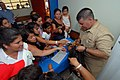 US Navy 070630-N-8704K-049 Senior Chief Hospital Corpsman Anthony Aubright, attached to Military Sealift Command hospital ship USNS Comfort (T-AH 20), hands out stuffed animals to children at Medical Center Morales.jpg