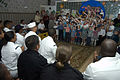 US Navy 070702-N-5253W-001 Sailors from guided-missile destroyer USS Curtis Wilbur (DDG 54) and submarine tender USS Frank Cable (AS 40) enjoy a song performed by children at the Parus Nadezhdy Children's Rehabilitation Center.jpg
