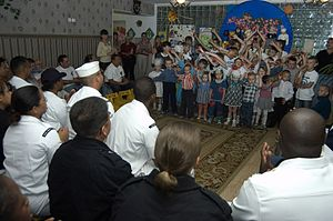 Russia–United States relations - U.S. Navy sailors with orphaned children in Vladivostok, Russia, July 2, 2007