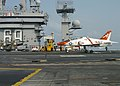US Navy 070817-N-1063M-002 A T-45C Goshawk lands on the flight deck of Nimitz-class aircraft carrier USS Dwight D. Eisenhower (CVN 69).jpg