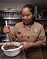 US Navy 070926-N-4856C-005 Culinary Specialist 3rd Class Elizabeth Garcia-Vargas, from Monterey Bay, Calif., mixes brownie batter in the commanding officer's galley aboard amphibious assault ship USS Iwo Jima (LHD 7).jpg