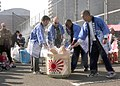 US Navy 071201-N-7446H-060 Chief petty officers from the U.S. Navy and the Japan Maritime Self-Defense Force (JMSDF) use mallets to break open a sake barrel during a mochi-pounding celebration at the JMSDF Yokosuka base.jpg