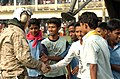 US Navy 071203-N-1831S-198 Bangladeshi citizens thank crew members assigned to the amphibious assault ship USS Kearsarge (LHD 3) for delivering food and other necessary supplies to them.jpg