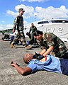 US Navy 081222-N-9995B-001 Hospital Corpsman 3rd Class Joe Davies, top left, observes Panamanian National Air and Maritime Service personnel during a Southern Partnership Station mass casualty training exercise.jpg