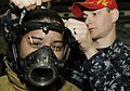 US Navy 090518-N-3595W-054 A student from Westbury High School in Long Island, N.Y. enrolled in the U.S. Naval Sea Cadet program tries on fire-fighting gear.jpg