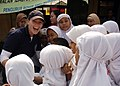 US Navy 090825-N-8539M-060 Ensign Ashley Rushing, assigned to the guided-missile destroyer USS Russell (DDG 59), greets a group of Indonesian girls at Nural Falah Elemetary School.jpg