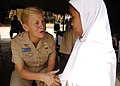 US Navy 090825-N-8539M-109 Rear Adm. Nora Tyson, commander, Logistics Group Western Pacific, meets a young student at Nural Falah Elemetary School.jpg