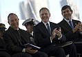 US Navy 091107-N-5549O-077 New York City Mayor Michael Bloomberg, left, Secretary of the Navy (SECNAV) the Honorable Ray Mabus and Northrop Grumman President of Shipbuilding Mike Petters applaud during the commissioning ceremon.jpg