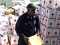 US Navy 100122-N-7923C-004 Boatswain's Mate 2nd Class Alde Aadam helps other American and Mexican Sailors unload boxes of food and humanitarian supplies donated by Mexico.jpg