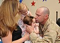 US Navy 100512-N-9095H-022 Master-At-Arms 1st Class Jason Morris, assigned to Maritime Expeditionary Security Squadron (MESF) 4, kisses his daughter after seeing her for the first time.jpg