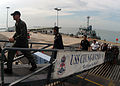US Navy 100709-N-0995C-002 U.S. and Republic of Singapore Sailors and Airmen cross the brow of USS Chung-Hoon (DDG 93).jpg