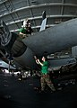 US Navy 100821-N-4830B-018 Air framers aboard the aircraft carrier USS George Washington (CVN 73) reattach the rear horizontal stabilizer of an F-A-18E Super Hornet from the Eagles of Strike Fighter Squadron (VFA 115).jpg