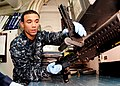 US Navy 100929-N-5538K-014 Gunner's Mate 2nd Class Edward P. Oyola cleans an M-240B machine gun in the armory of USS Essex (LHD 2).jpg