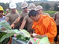 US Navy 110118-N-8372H-001 A Thai monk blesses the first column of new construction for Pa Ka Mai school as Seabees assigned to Naval Mobile Constr.jpg