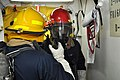 US Navy 110311-N-7293M-142 Damage Controlman 3rd Class Adam Beach gives instructions to Damage Controlman Fireman Jamie Parker while containing a s.jpg