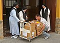 US Navy 110506-N-AW868-041 Religious Programs Specialist 2nd Class Shaun-Michael VanAsselberg delivers food to the sisters of Espiritu Santo conven.jpg