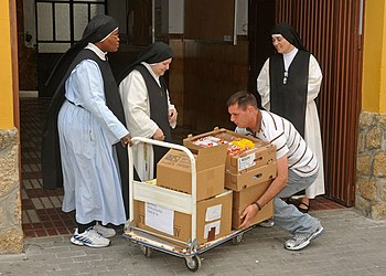 US Navy 110506-N-AW868-041 Religious Programs Specialist 2nd Class Shaun-Michael VanAsselberg delivers food to the sisters of Espiritu Santo conven