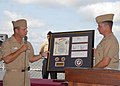 US Navy 110805-N-VK779-095 Capt. Joe Mauser presents a plaque to Cmdr. Sylvester Steele during a ceremony highlighting the March 19 combat launch o.jpg