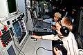 US Navy 111003-N-BS854-264 Children from Parus Nadezhdy Children's Rehabilitation Center touch equipment in the Combat Information Center aboard th.jpg
