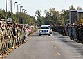 US Navy 111117-N-SN160-006 Service members and civilians pay respect line the road along a funeral procession to pay respects to Chief Builder Raym.jpg