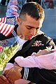 US Navy 111214-N-AW702-004 A Sailor sees his newborn daughter for the first time.jpg