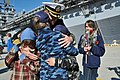 US Navy 120207-N-QY430-112 Capt. Erik Ross, commanding officer of the amphibious assault ship USS Bataan (LHD 5), greets his family during a homeco.jpg