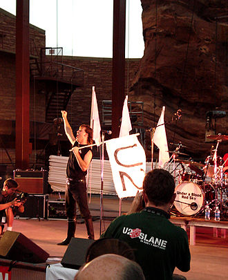 """U2 Live at Red Rocks: Under a Blood Red Sky - In 2007, the U2 tribute act """"Under a Blood Red Sky"""" reenacted U2's Red Rocks show."""