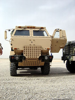 Improvised vehicle armour - A U.S. Army LMTV cargo truck with up-armoured cab.