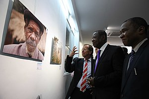 Internally displaced person - Official opening of MONUSCO's photo exhibition organized in the framework of the 70th anniversary of the United Nations. In the photo are the Head of MONUSCO, Martin Kobler (1st left), Lambert Mende (middle), and the Director of MONUSCO Public Information Division, Charles Antoine Bambara, commenting on a picture showing an internally displaced person.