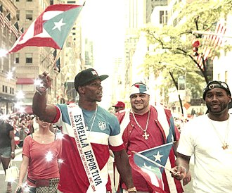 Puerto Rican Day Parade - New York Giants players Victor Cruz and Frankie Cutlass march in the 2014 parade