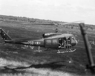 Bell UH-1 Iroquois - Republic of Vietnam Air Force (VNAF) UH-1H lands during a combat mission in Southeast Asia in 1970