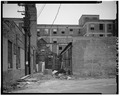 View east, rear facade, service alley - Indiana Hotel, 5116 Hohman Avenue, Hammond, Lake County, IN HABS IND,45-HAMM,2-13.tif