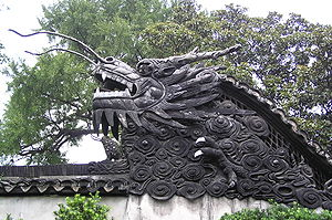 Horned dragon roof decoration in Yuyuan Garden...