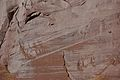 Wingate Sandstone (Upper Triassic) with desert varnish, Fremont Petroglyphs Cliff, Capitol Reef National Park, southern Utah 10 (8445592720).jpg