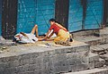 Woman is massaging a man in Nepal.jpg