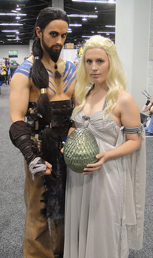 A Song of Ice and Fire fandom - Two fans costumed as Khal Drogo and Daenerys Targaryen. Cosplay is a popular activity at fan conventions.