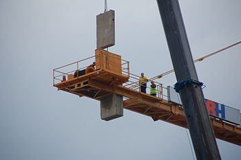 Workers dismantling a construction crane