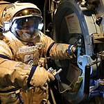 Working on the airlock hatch in the Orlan (8101826025).jpg