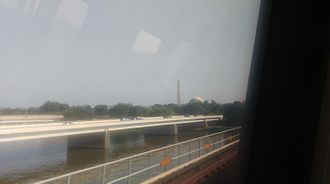 Yellow Line (Washington Metro) - Crossing the Potomac River from Virginia on the Yellow Line, with the Washington Monument and Jefferson Memorial in the background